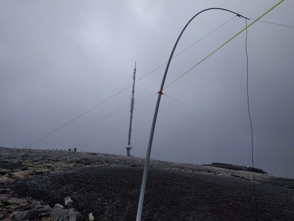 My fibreglass pole with wire antenna in the foreground, main transmitter mast in the background