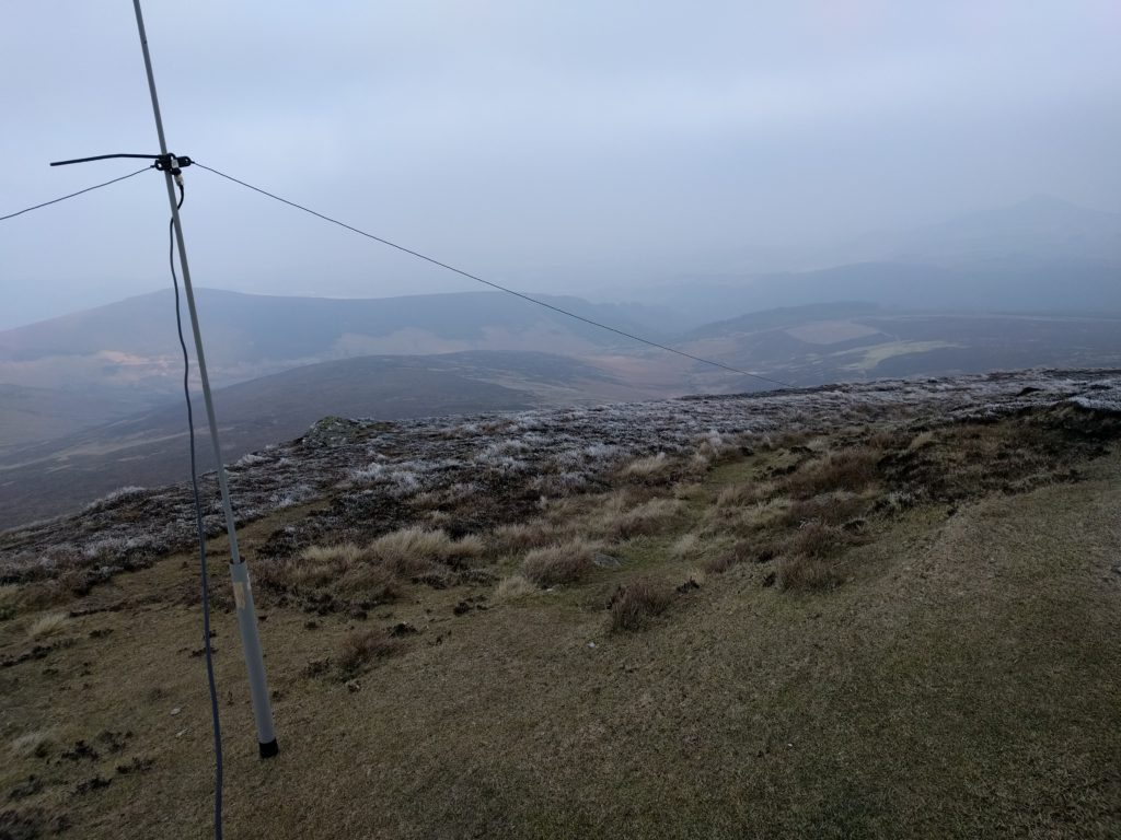 Low fibreglass pole and dipole, with hills in background