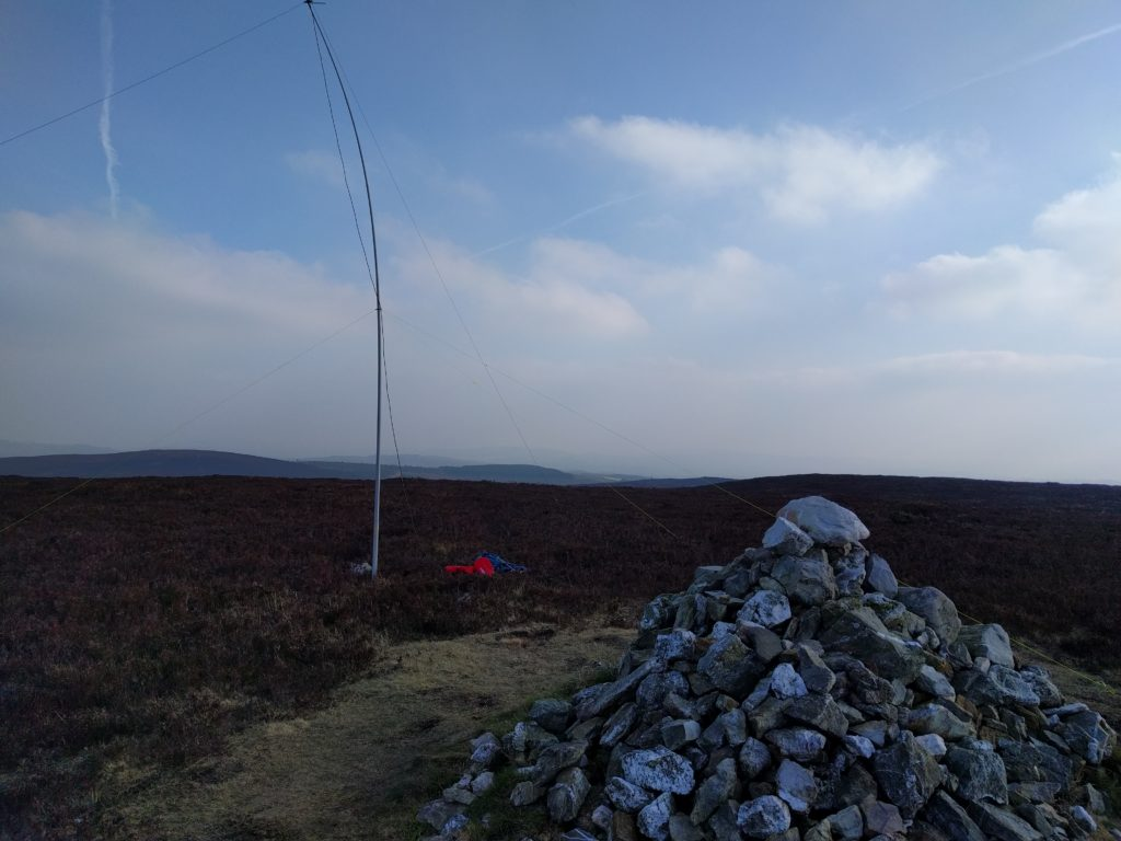 Cairn in foreground, mast in surrounding heather