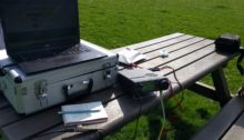 Park bench with radio equipment on top