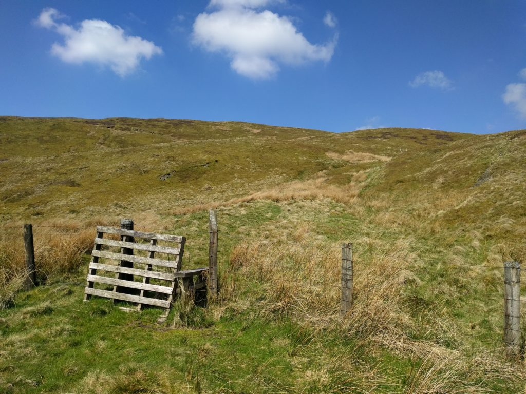Stile over fence to moorland