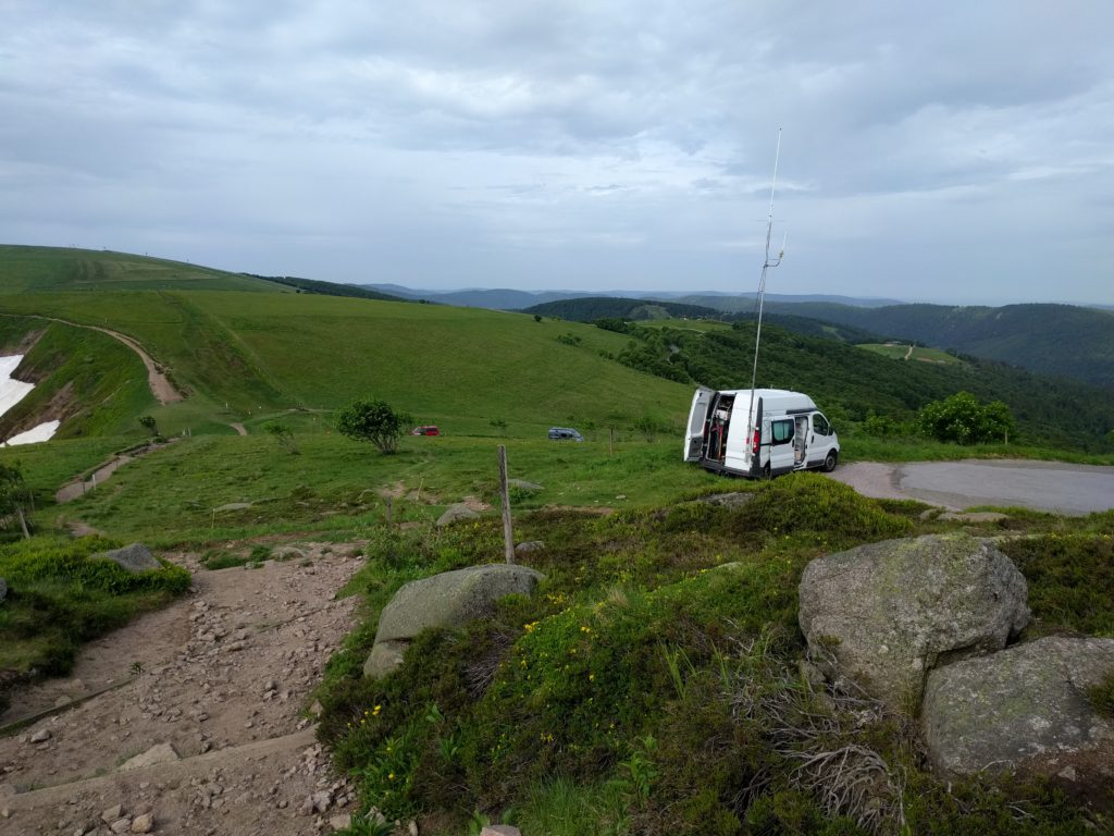 Van with mast parked by the roadside