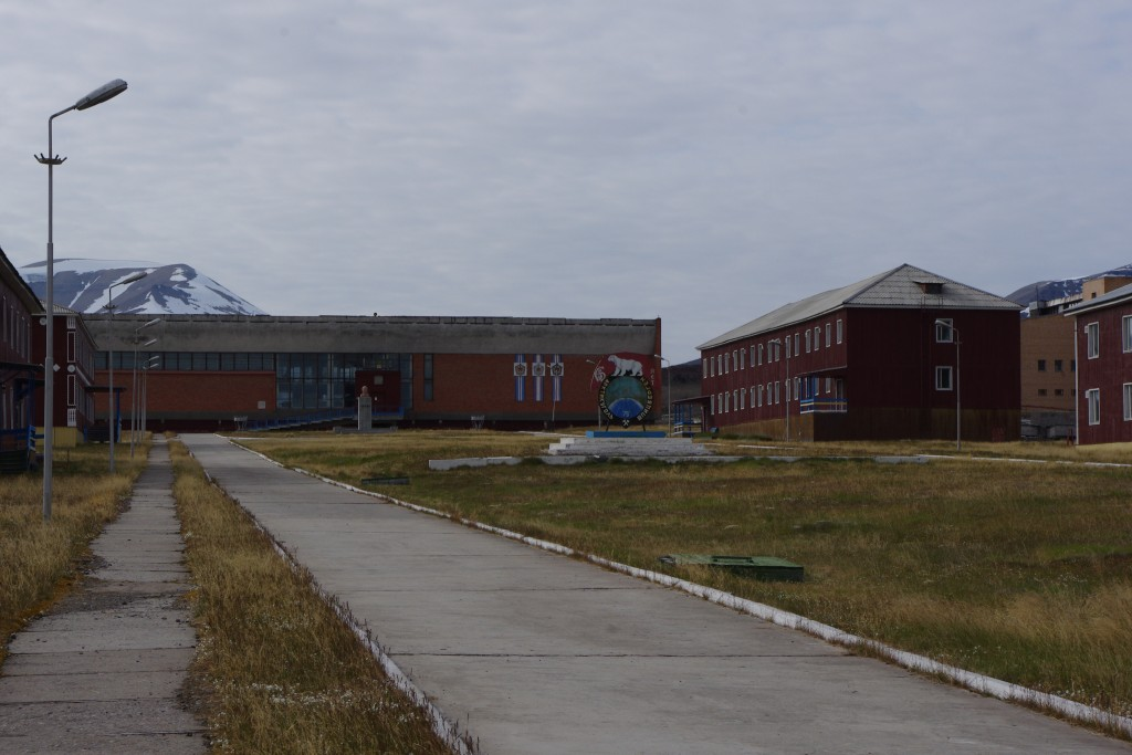 The main street on Pyramiden, called '60th Anniversary of the October Revolution Street', looking towards the Cultural Centre and statue of Lenin.
