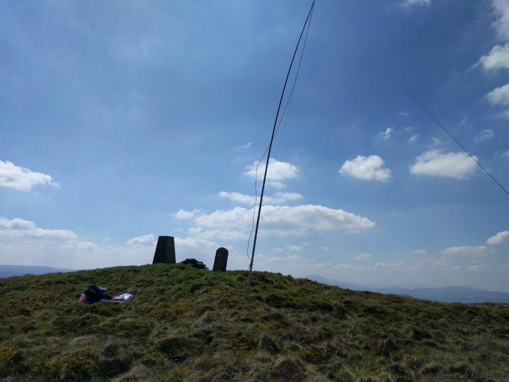 Antenna next to trig point on summit