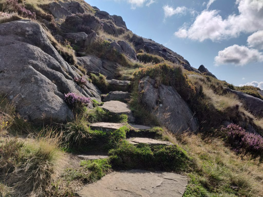 Stone path going up hill, surrounded by boulders